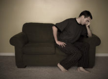 Man suffering anxiety on couch